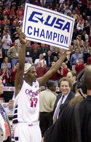 UC's Leonard Stokes celebrates after UC beat Marquette in the Conference USA Championship game Saturday March 9, 2002.