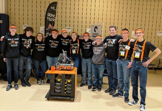 "Members of Loveland Robotics FTC team Bionic Tigers"" pose with their robot during a competition earlier in this season as they attempt to qualify for the FTC Worlds in April."