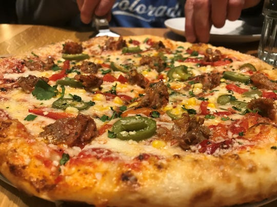 Harvest Pizzeria's Spicy Yuma pizza is basically a (mouth-wathering) fancy Mexican pizza.