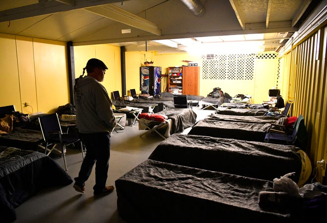 Kenny York, founder and CEO of Manna Cafe Ministries, walks through a warming shelter in Clarksville, Tenn.