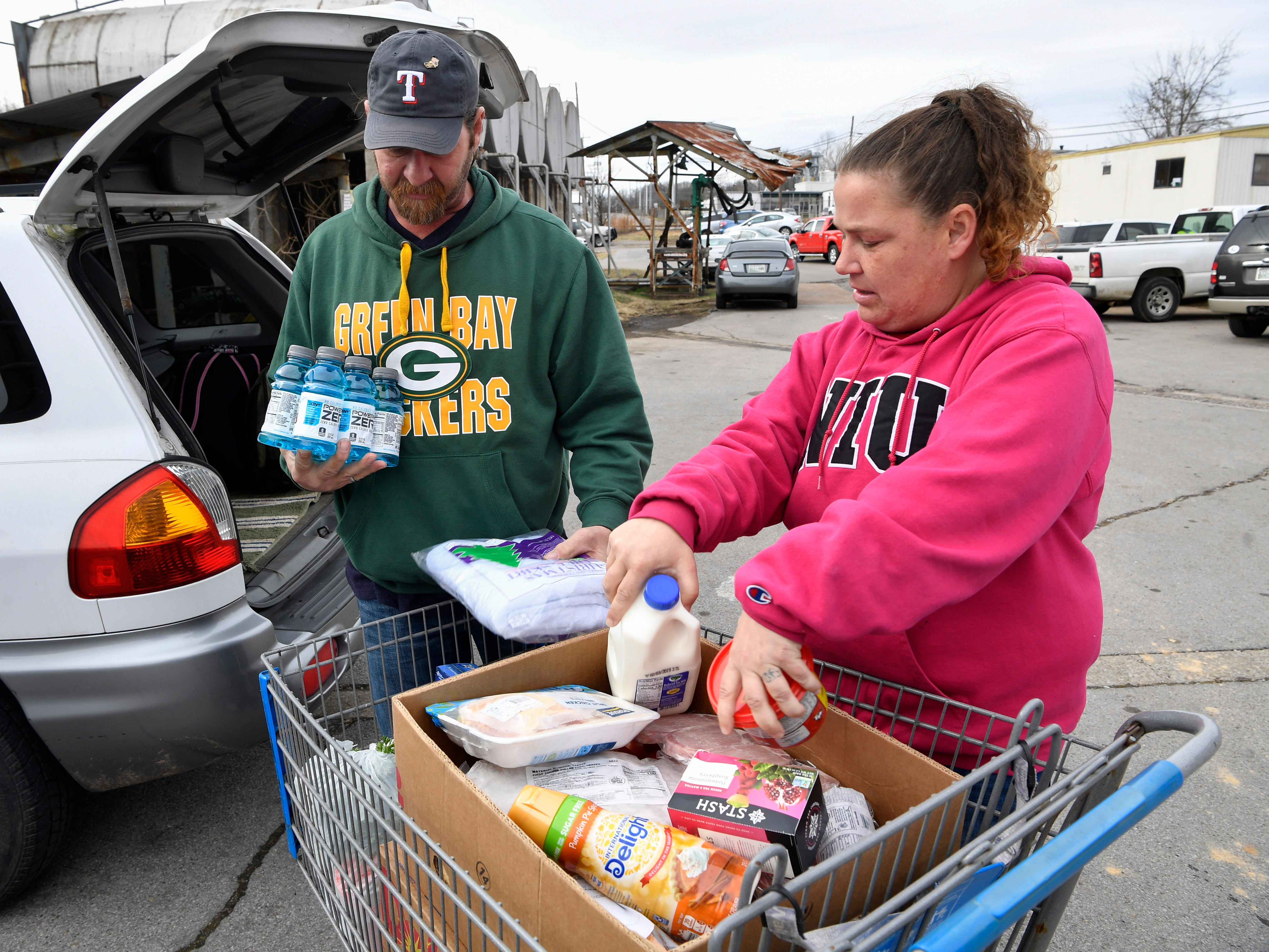 Tommi Jo French and Eddie Goering pick up food at the Manna Cafe Monday, Jan. 28, 2019, in Clarksville, Tenn.. They have been living on the streets but just recently acquired an apartment.