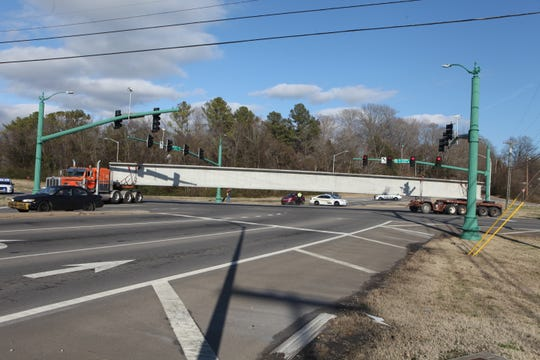 Four 130-foot-long steel beams for the McClure Bridge project were transported through Clarksville on Friday, Feb. 1, temporarily blocking the intersection of Riverside Drive and Highway 48/13.