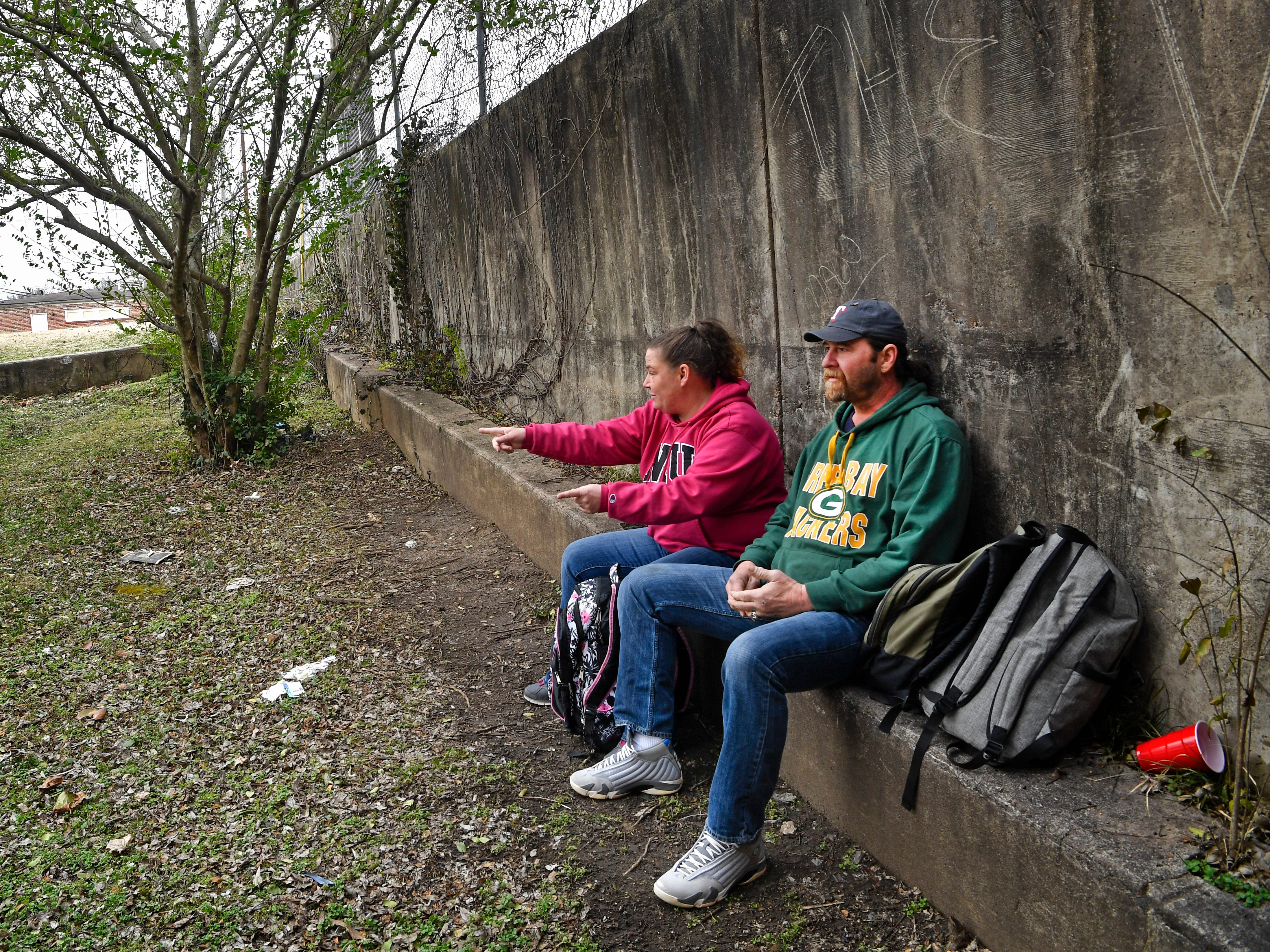 Tommi Jo French and Eddie Goering return to the vacant lot Monday, Jan. 28, 2019 in downtown Clarksville where they pitched a tent while homeless. They recently acquired an apartment.
