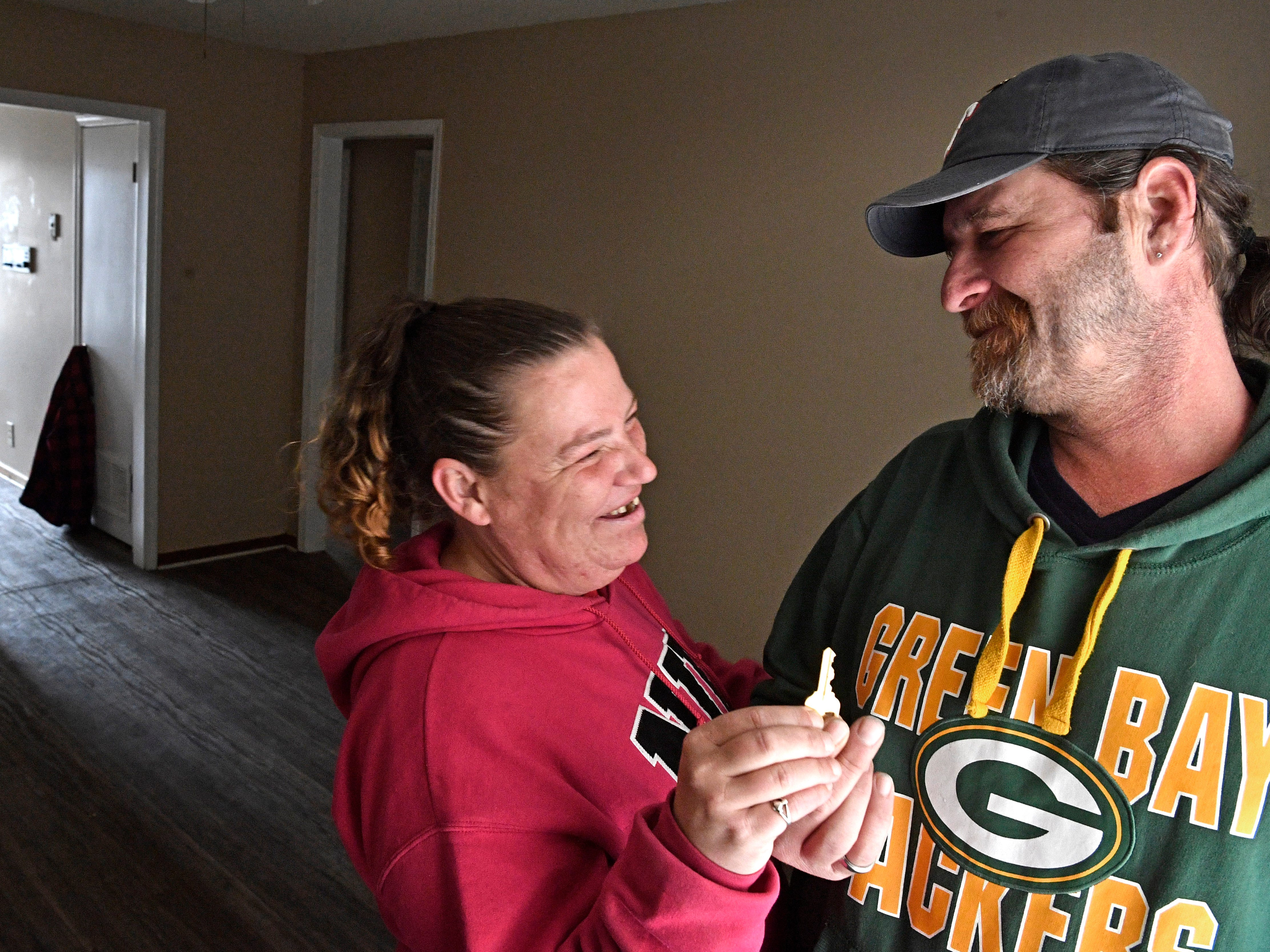 Even though the only furniture they have is a bed, Tommi Jo French and Eddie Goering are so proud that they have a key to their own apartment and now have a roof over their heads after being homeless for months.