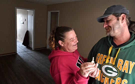 Even though the only furniture they have is a bed, Tommi Jo French and Eddie Goering are excited to have a key to their own apartment a roof over their heads after being homeless for months.