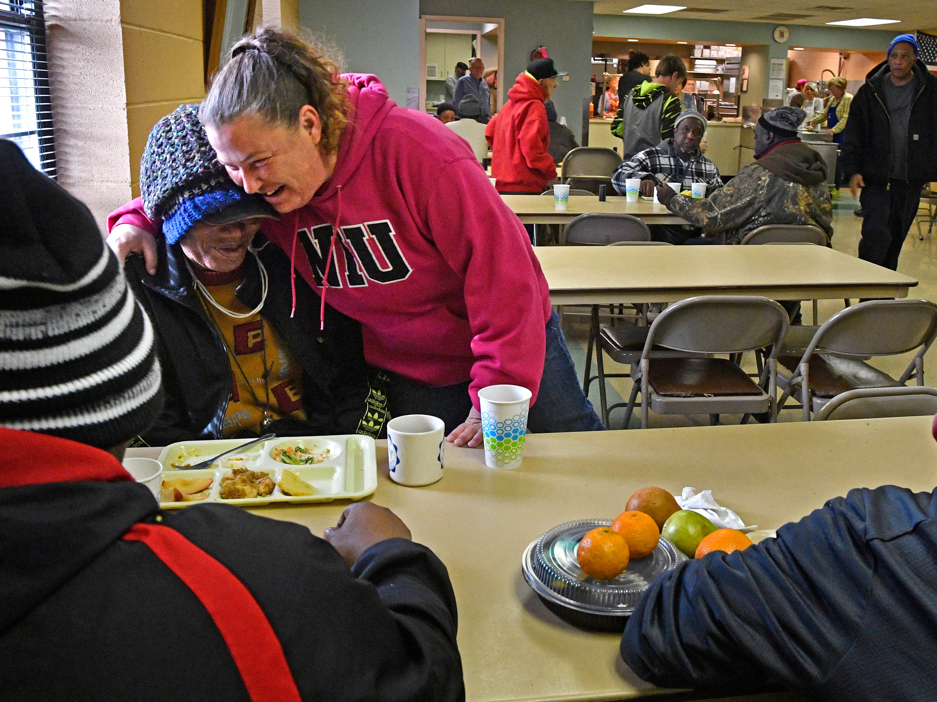 Tommi Jo French gives a hug as she talks with Charles Gaines at the Loaves and Fishes food ministry where they have received many meals while being homeless Monday, Jan. 28, 2019, in Clarksville, Tenn.