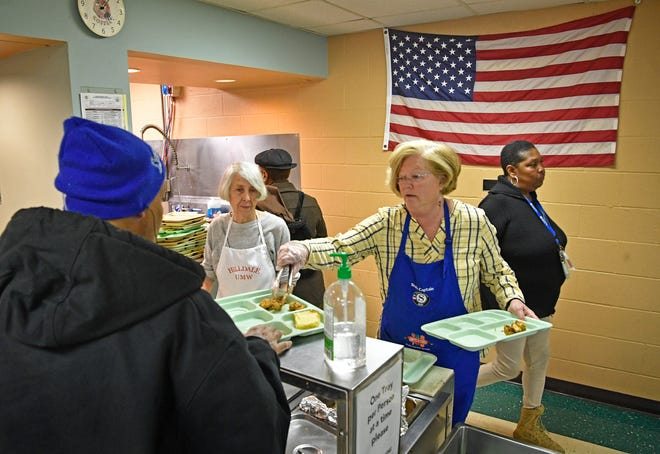 Volunteers Ann Morris and Ann Thompson serve food to those in need at the Loaves and Fishes food ministry Monday, Jan. 28, 2019, in Clarksville, Tenn.