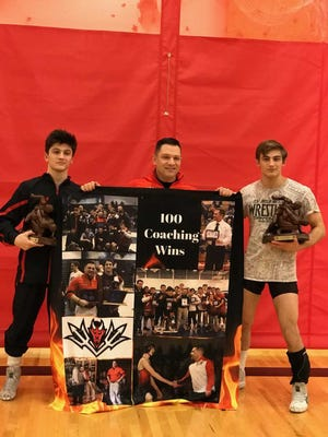 Hunterdon Central's Jack Bauer, head coach Jon Cantagallo-Rohm and Vincent Romaniello were honored for reaching career milestones following the win over Voorhees on Jan. 30, 2019.