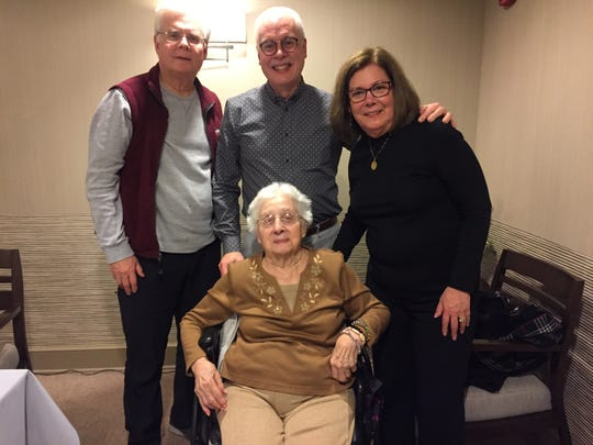 At my mother's 99th birthday celebration this past Sunday, Jan. 27: from left to right, son James Grzella, son Paul Grzella, and daughter Joan Church, with our mom, Rose Grzella.