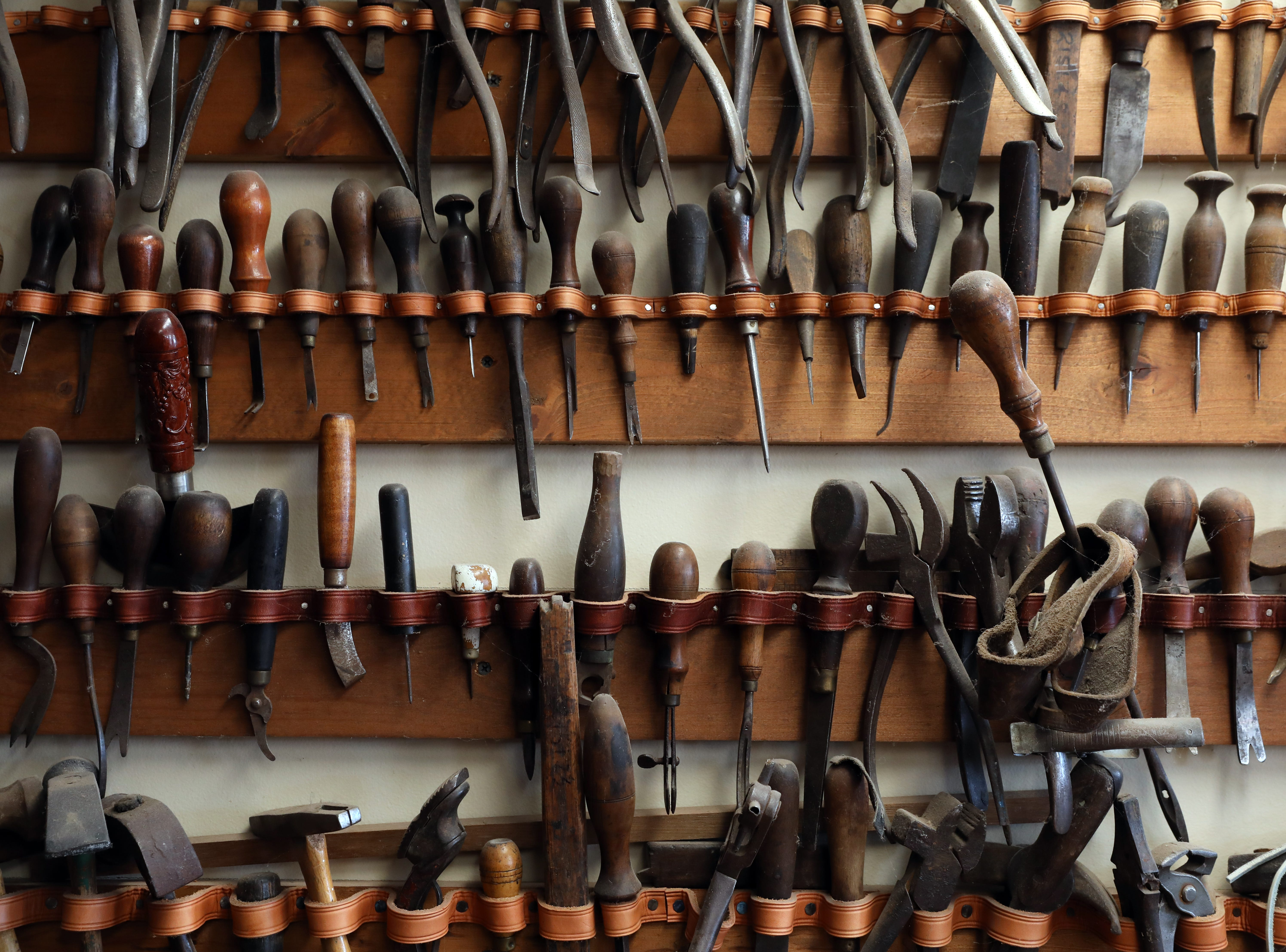 Owner Dennis Knight's collection of antique leatherworking tools at River Ridge Leather Company in Roscoe Village.