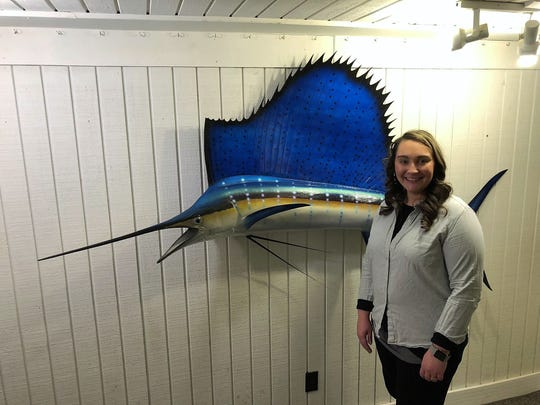 "Christina Herriman stands beside the 7' 7"" sailfish she caught off the coast of Miami. This sailfish will be displayed at the annual Tri-County Wild Game Dinner on Feb. 23 at Chile Crossroads Bible Church. Tickets may be purchased at www.chiliwildgame.com."