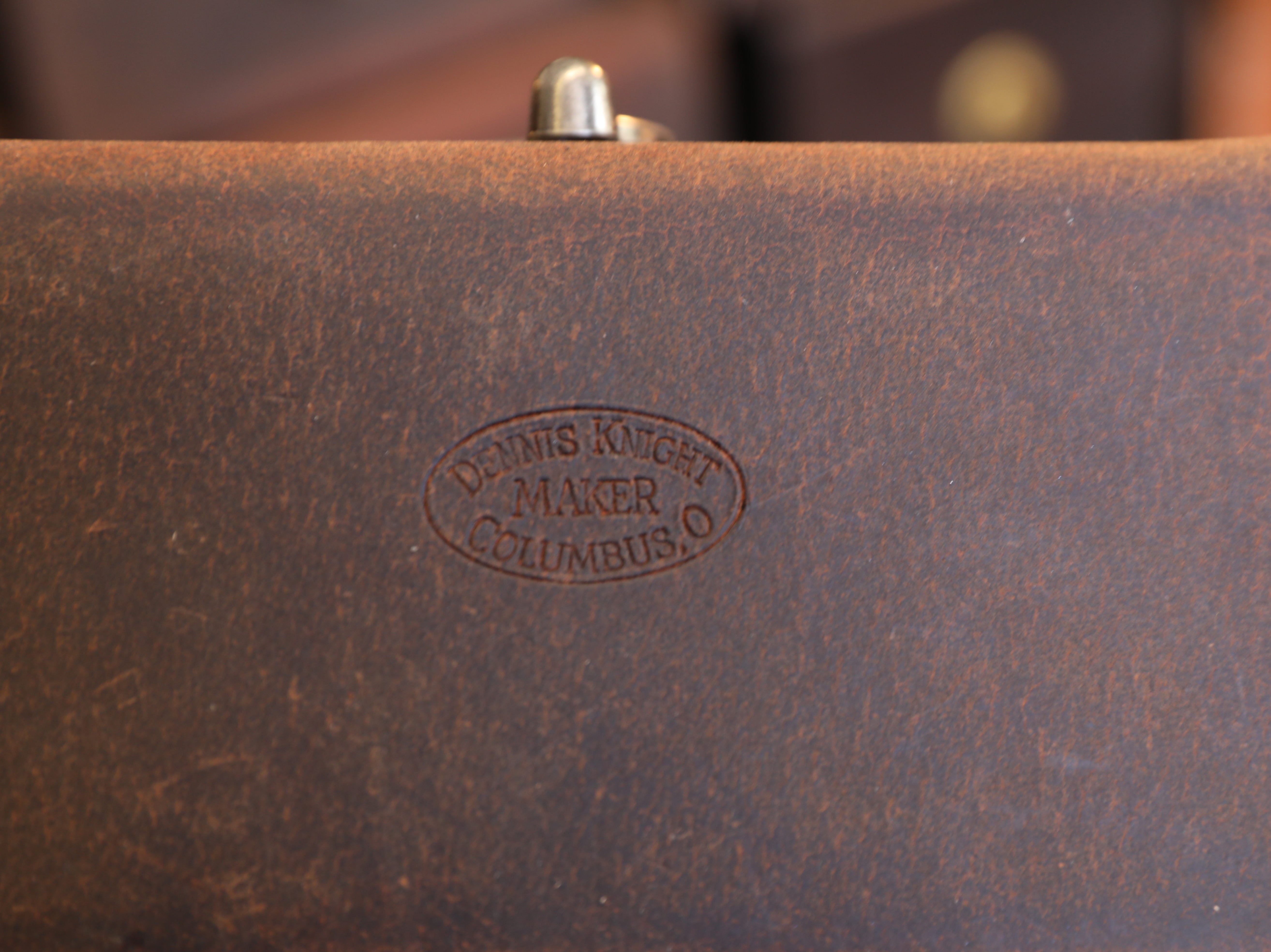 Dennis Knight's mark on a bag at River Ridge Leather Company in Roscoe Village.