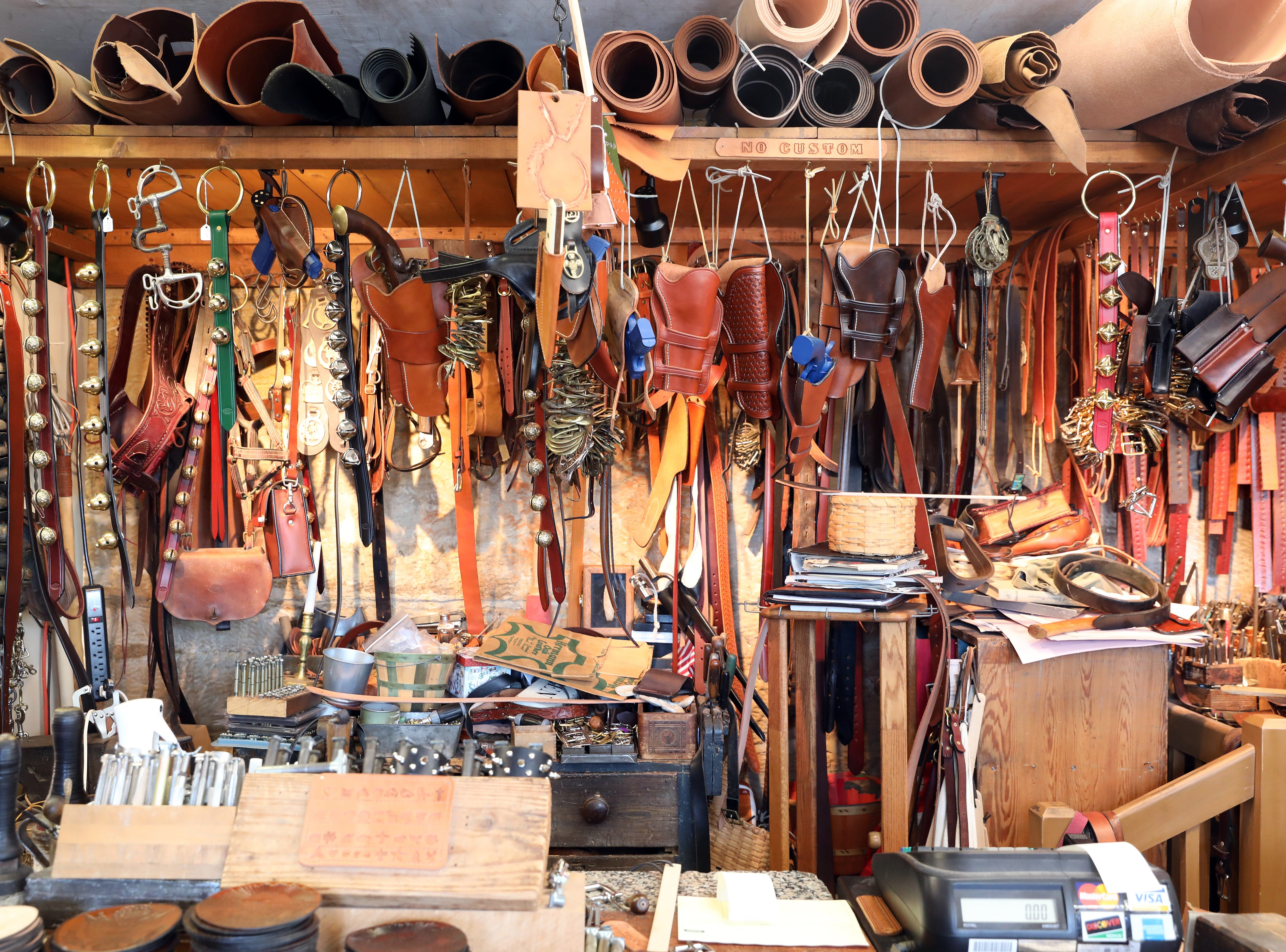 Rolls of leather and finished products at River Ridge Leather Company in Roscoe Village.