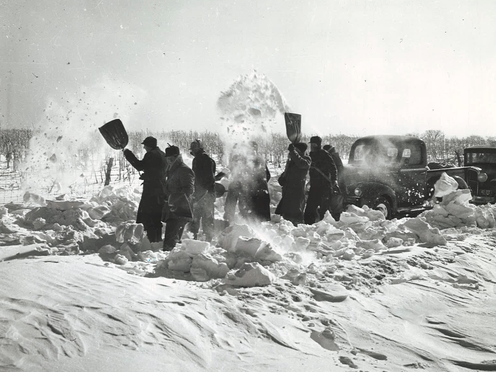 From 1940: This group of farmers was found shoveling out a road between Attica and Highway 14 after they had been snowbound for a week. A truck owned by Pearl Pearson led the way.