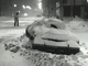 From 1981: This car left on a snow route was buried by falling snow and plows clearing Fifth and Walnut streets in January 1981.