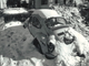 From 1982: This frozen VW bug, which has been exterminated and half-buried by bad weather, sits in drifted snow at the corner of 30th and Hickman in Des Moines.
