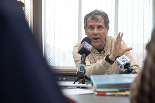 Potential presidential candidate U.S. Sen. Sherrod Brown, D-Ohio, takes part in a roundtable discussion at the library in Perry Friday, Feb. 1, 2019.