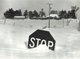 From 1982: A stop sign stands nearly buried at the end of a short stretch of gravel road on the north edge of Marion in Linn County.