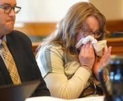 Josie Raye Bousman, 22, of Perry, becomes emotional Friday, Feb. 1, 2019, as victim impact statements are read before she is sentenced to 14 years in prison at the Dallas County Courthouse in Adel, Iowa.