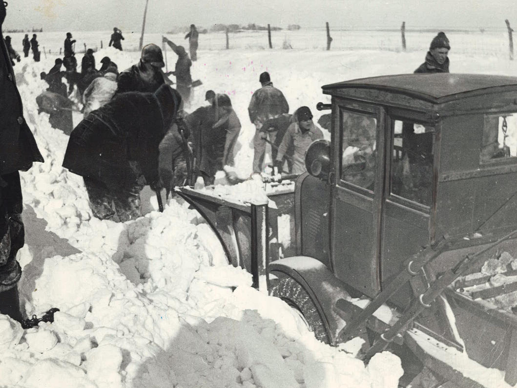 From 1936: It took dozens to clear roads after a blizzard near Waverly.