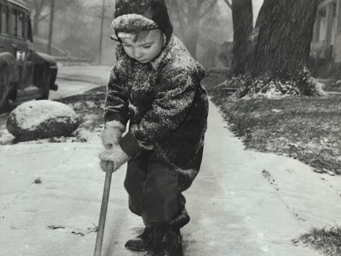 "From 1946: The first ""sticking"" snowfall of the season fell Dec. 13, 1946. Jimmy Croskey, 4, son of Mr. and Mrs. James Croskey, helped clear the sidewalk in front of his 34th Street home in Des Moines."