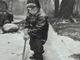 """From 1946: The first """"sticking"""" snowfall of the season fell Dec. 13, 1946. Jimmy Croskey, 4, son of Mr. and Mrs. James Croskey, helped clear the sidewalk in front of his 34th Street home in Des Moines."""