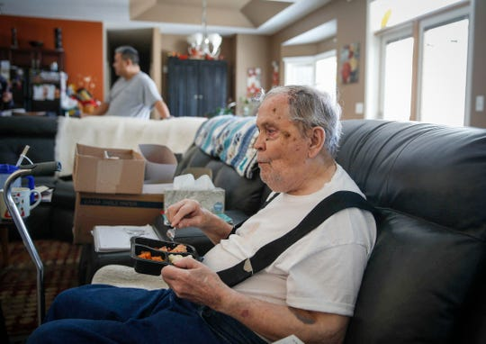 Gene Creech, 90, watches a television program while eating lunch from Meals on Wheels at his home on Friday, Feb. 1, 2019, in Urbandale.