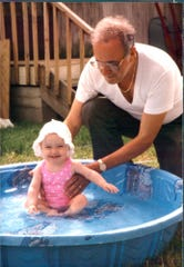 Columnist Courtney Crowder as a baby with grandfather, who recently passed.