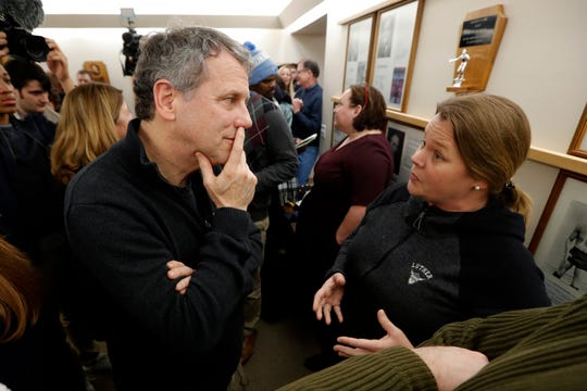 U.S. Sen. Sherrod Brown, D-Ohio, talks with Britt Rhodes, of Decorah, Iowa, during a meet-and-greet with local residents, Thursday, Jan. 31, 2019, in Cresco, Iowa.