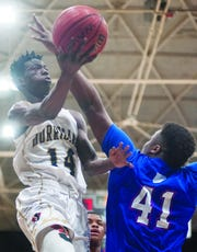 Iowa State signee Marcedus Leech (14) attempts a lay-up during his senior year at Jonesboro.