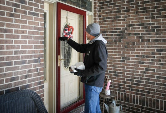 Brian Joens, a delivery driver for the WesleyLife Meals on Wheels program, delivers a meal to Gene Creech's home on Friday, Feb. 1, 2019, in Urbandale.