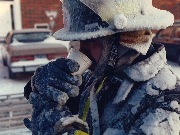 An unidentified Des Moines fire fighter takes a break from a call to attempt to warm up.