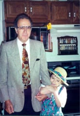 Columnist Courtney Crowder as a girl with grandfather, who recently passed.