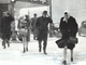 From 1946: As high wind whirled snow on downtown Des Moines streets, shoppers bent their heads to protect themselves. View is looking west at Seventh and Locust streets.