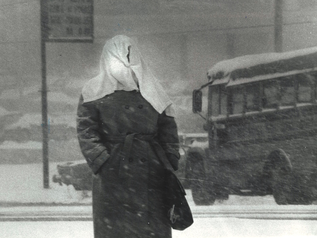 From 1982: The wet April snow caught many Iowans by surprise. This Mercy Hospital nurse coming off duty at 7:30 a.m. uses a towel held with a safety pin for emergency head covering.