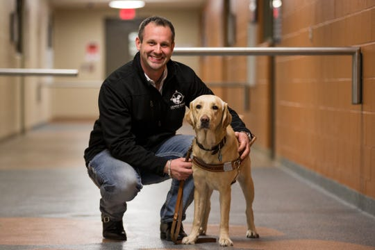 Dave Bann, Leader Dogs fort the Blind corporate engagement manager and his dog Coco at the Leader Dogs for the Blind campus in Rochester Hills, Tuesday, Jan. 1, 2019.