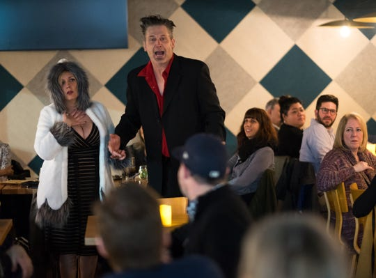 Actors Tom Kollenberg of Royal Oak and Krissi Kinney of Utica played a boozy Birmingham power couple at the January mystery dinner.
