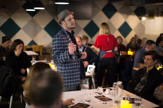 On The Town Riddles owner and creative director Kris Caster speaks to guests during January's immersive theater event at Red Dunn Kitchen.
