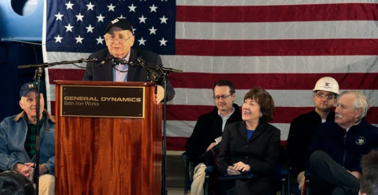 Former Sen. Carl Levin, of Michigan, addresses a gathering at Bath Iron Works, where a warship that bears his name is under construction, Friday, Feb. 1, 2019, in Bath, Maine. In the front row from left are U.S. Navy Secretary Richard Spencer, Levin, U.S. Sen. Susan Collins (R-Me.) and U.S. Sen. Angus King (I-Me.).