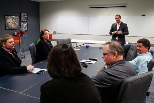 Dave Bann, Leader Dogs for the Blind corporate engagement manager, presents to a group during a Harness the Power of Leadership session at Mitsubishi Motors R&D Of America Ann Arbor Laboratory in Ann Arbor, Tuesday, Jan. 29, 2019.