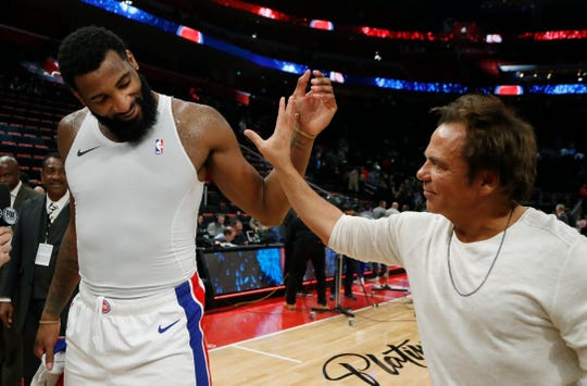 Detroit Pistons owner Tom Gores greets center Andre Drummond after the team's 93-89 win against the Dallas Mavericks, Jan. 31, 2019, in Detroit.