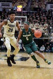 Cassius Winston moves the ball in Michigan State's loss to Purdue on Sunday.
