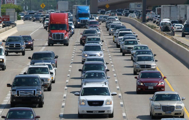 Drivers work their way out of Dallas during rush hour Friday, July 1, 2016.