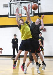 Michael McGrath, right, leads Clarkston Everest in scoring and rebounds.