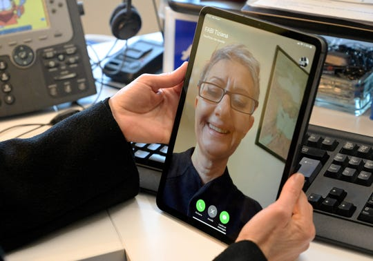 A woman uses her Ipad for a Facetime conversation, on January 29, 2019 in Rome.
