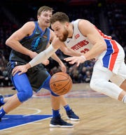Pistons' Blake Griffin drives around Mavericks' Ryan Broekhoff in the second quarter.