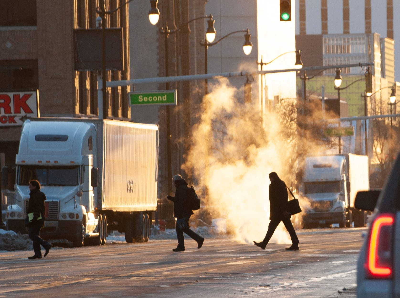 Temperatures rose above zero Friday, but things were still extremely frigid as commuters cross Fort Street in downtown Detroit around 5 p.m. with temperatures hovering around 10-degrees on Friday, February 1, 2019.