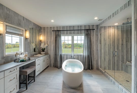 One of the advantages of buying a new home is the up-to-date layout designed to cater to buyer's current wish lists, such as larger bathrooms and walk-in closets.