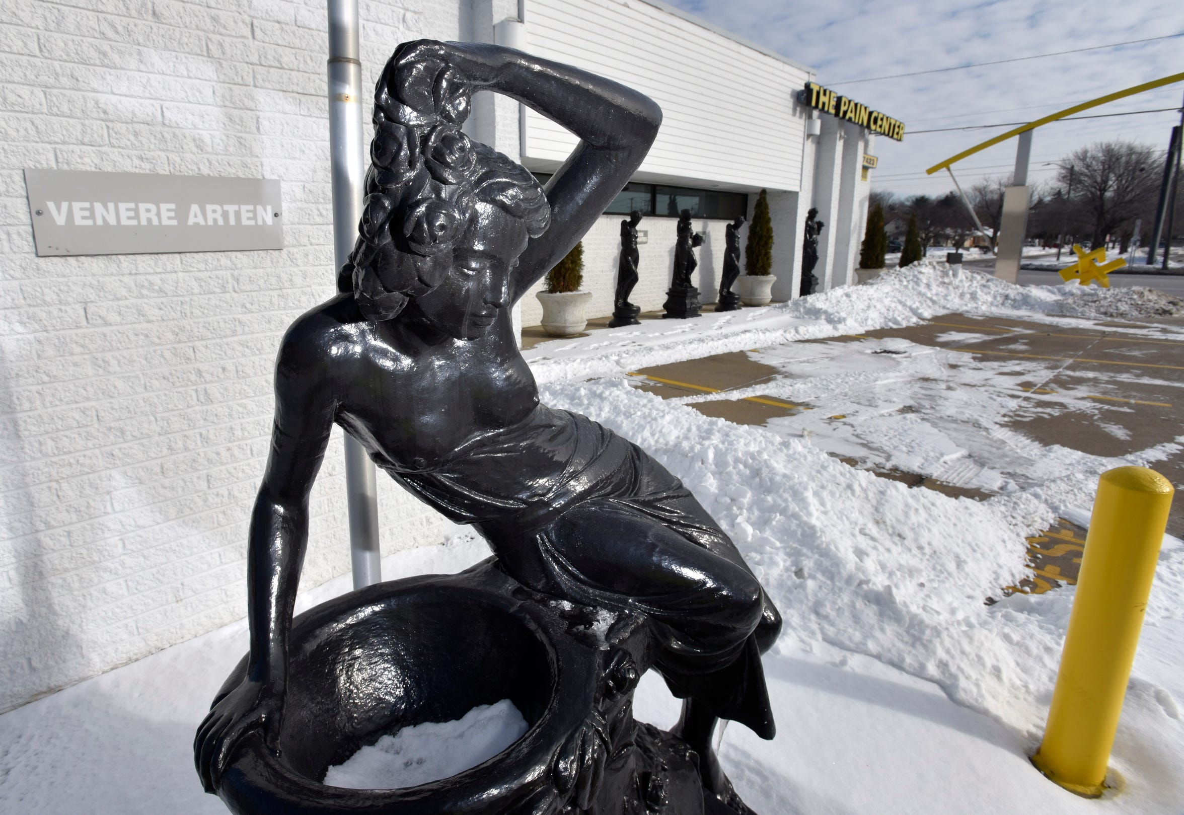 A statue of Greek goddess Venere Arten is displayed with other goddess statue outside The Pain Center, a closed business in Warren.  The Warren health clinic, with Dr. Rajendra Bothra, of Bloomfield Hills, and a five-member medical team, was shut down by federal agents for operating an alleged multi-million dollar healthcare fraud, including, an illicit opioid scheme.