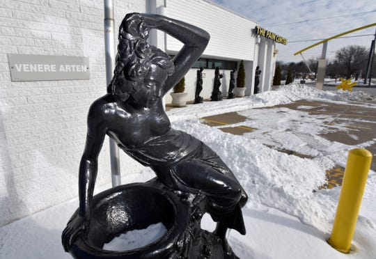 A statue of Greek goddess Venere Arten is displayed with other goddess statues outside The Pain Center in Warren, now closed. The clinic was shut down by federal agents on healthcare fraud charges.